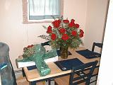2001-08-26.wedding.kevin-nessa.engagement.flowers.table.unpacking.plymouth.mi.us.jpg
