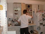 2002-05-13.humor.man_caught_putting_dishes_away.kevin-snyder.redford.mi.us.jpg