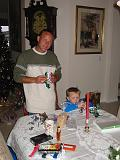 2004-12-25.opening_presents.dom-ethan.4.christmas.venice.fl.us.jpg