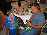 2004-12-25.opening_presents.ethan-dom.1.christmas.venice.fl.us.jpg