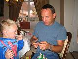 2004-12-25.opening_presents.ethan-dom.2.christmas.venice.fl.us.jpg