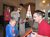 2004-12-25.opening_presents.kevin-snyder-ethan.2.christmas.venice.fl.us.jpg