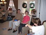 2004-12-25.opening_presents.wendy-sandy-snyder.1.christmas.venice.fl.us.jpg