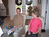 2004-12-25.opening_presents.wendy-sandy-snyder.2.christmas.venice.fl.us.jpg