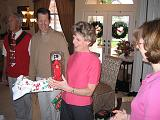 2004-12-25.opening_presents.wendy-sandy-snyder.3.christmas.venice.fl.us.jpg