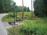 2005-08-18.signs.raps_road.3a.driveway.entrance.lake_cabin.cook.mn.us.jpg