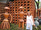 2004-07-10.tropical_gardens.pottery_figures.nessa-snyder.1.nong_nooch.th.jpg